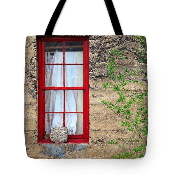 Tote Bag featuring the photograph Rock On A Red Window by James Eddy