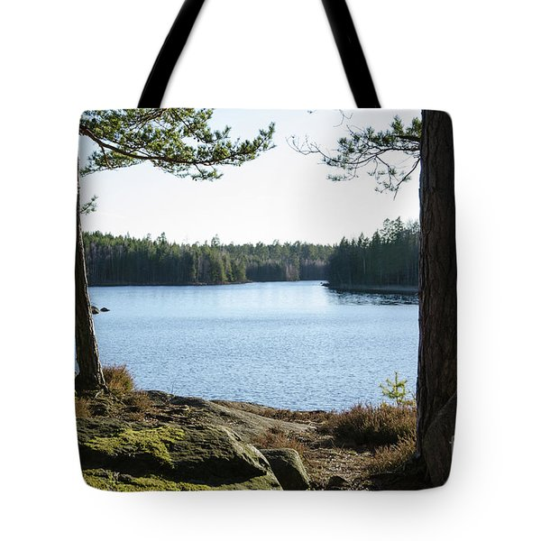 Tote Bag featuring the photograph Rocks And Tree Trunks By Lakeside by Kennerth and Birgitta Kullman
