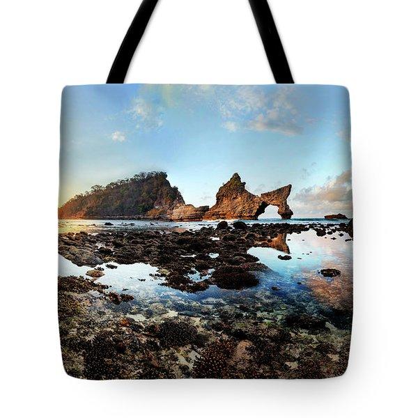 Tote Bag featuring the photograph Rocky Beach Sunrise, Bali by Pradeep Raja Prints