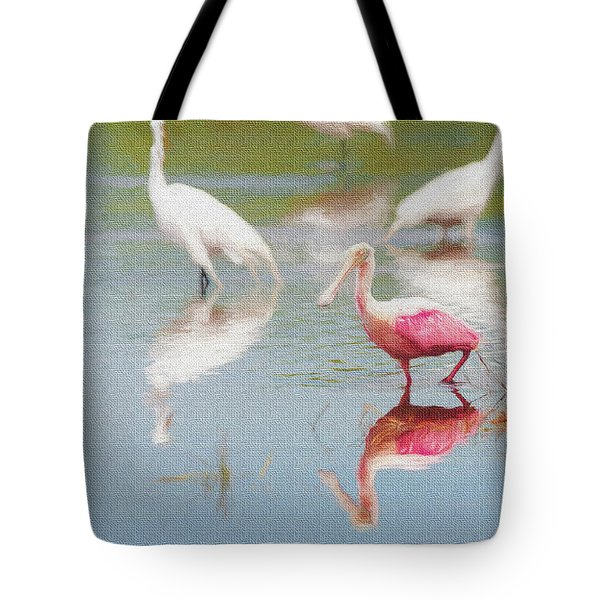 Roseate Spoonbill Eating In A Lagoon With Other Egrets Tote Bag