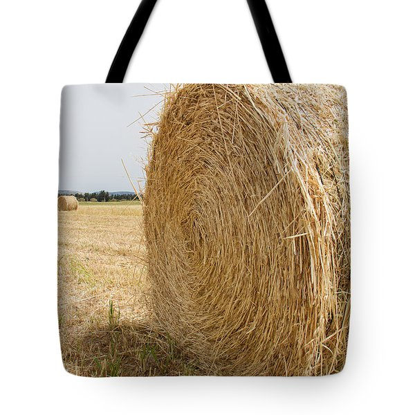 Round Hay Bales Arranged In Field Tote Bag