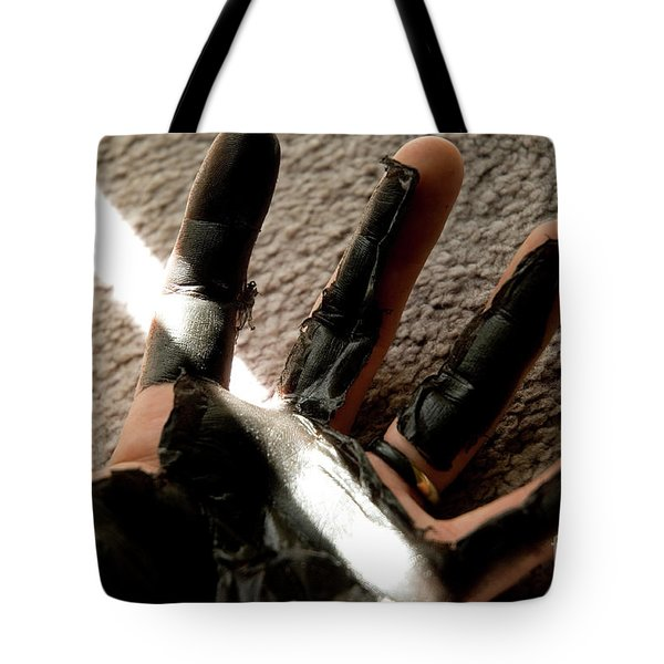 Tote Bag featuring the photograph Rubber Hand by Micah May