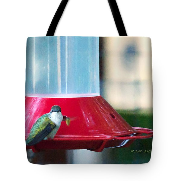 Tote Bag featuring the photograph Ruby-throated Hummingbird At Feeder by Edward Peterson