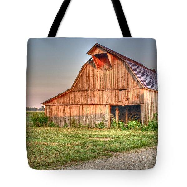 Ruddish Barn At Dawn Tote Bag by Douglas Barnett