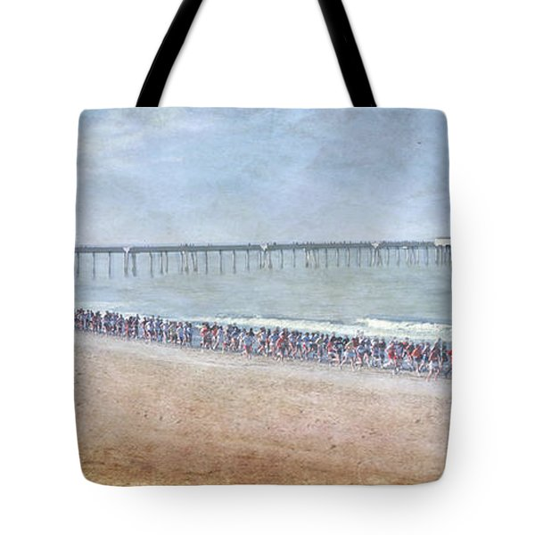 Tote Bag featuring the photograph Runners On The Beach Panorama by David Zanzinger