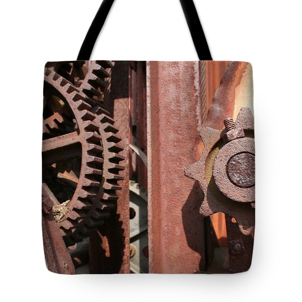 Tote Bag featuring the photograph Rusted Gears by Dylan Punke