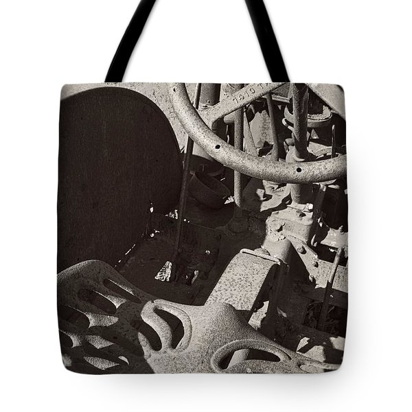 Tote Bag featuring the photograph Rusted Tractor by Michelle Calkins
