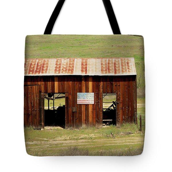 Tote Bag featuring the photograph Rustic Barn With Flag by Art Block Collections