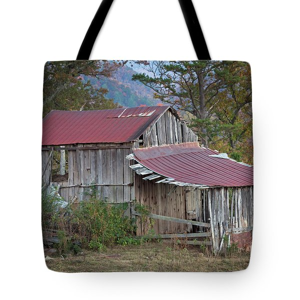 Tote Bag featuring the photograph Rustic Weathered Hillside Barn by John Stephens