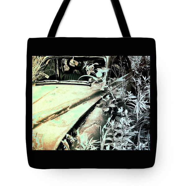 Tote Bag featuring the photograph Saab by Steve Godleski