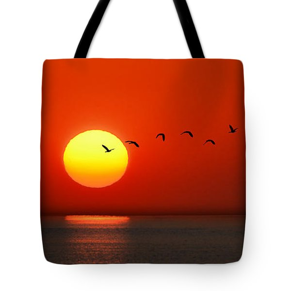 Tote Bag featuring the photograph Sailboat At Sunset by Joe Bonita