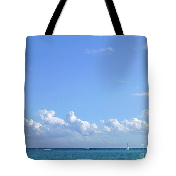 Tote Bag featuring the photograph Sailing Blue Seas by Francesca Mackenney