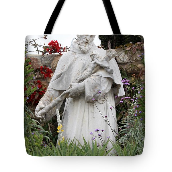 Saint Francis Statue In Carmel Mission Garden Tote Bag by Carol Groenen