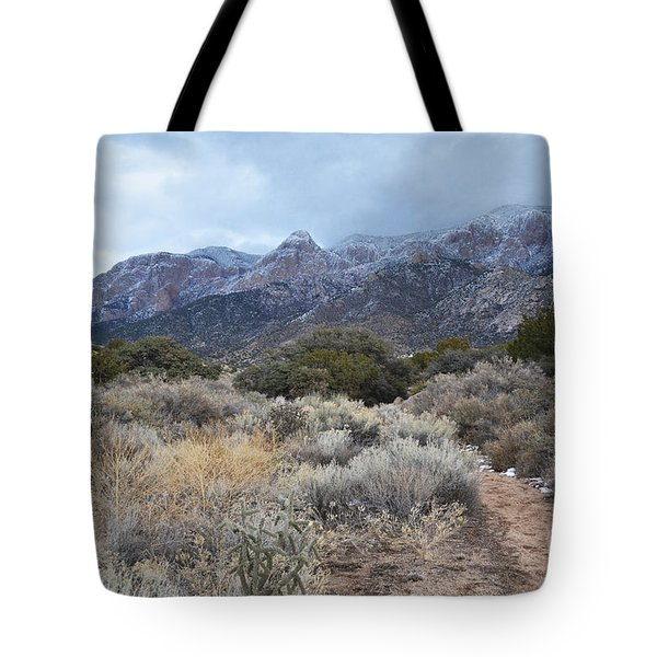 Sandia Mountains Storm Winter Landscape Tote Bag by Andrea Hazel Ihlefeld