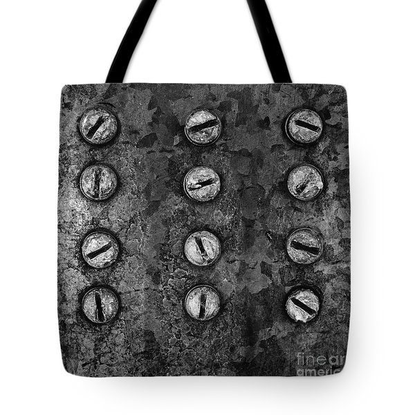 Tote Bag featuring the photograph Screws On Utility Box by Dutch Bieber