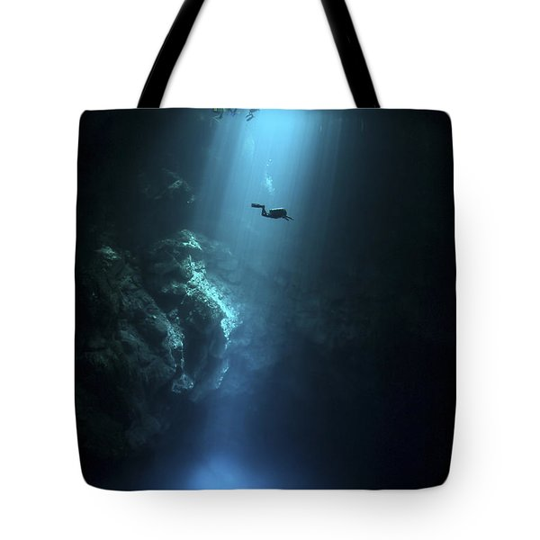 Scuba Diver Descends Into The Pit Tote Bag by Karen Doody
