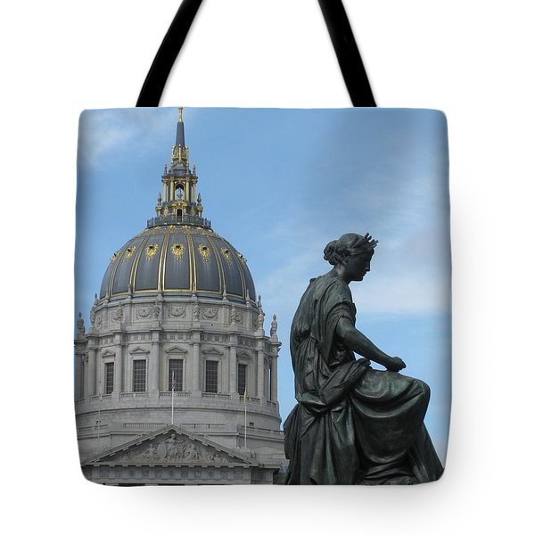 sculpture with City hall building Tote Bag