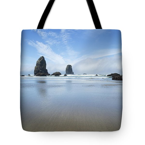 Tote Bag featuring the photograph Sea Stacks At Cannon Beach by Charmian Vistaunet