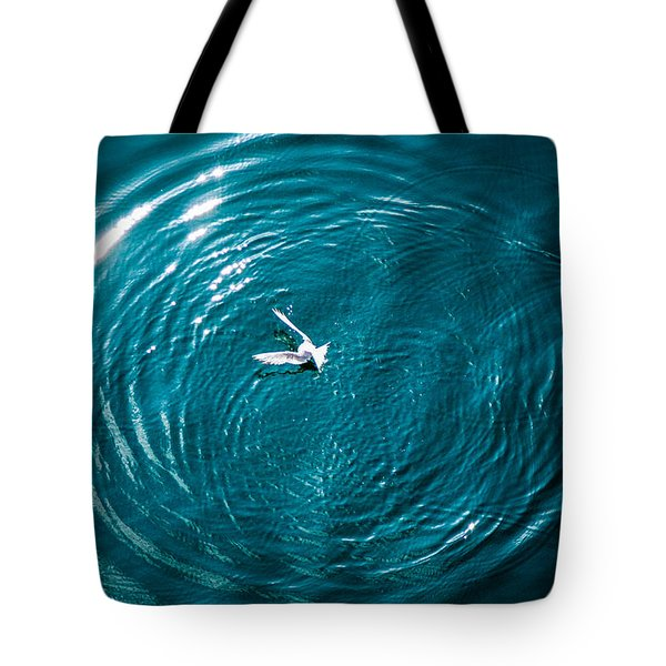 Tote Bag featuring the photograph Seagull Chasing Bait by Gregory Daley  PPSA