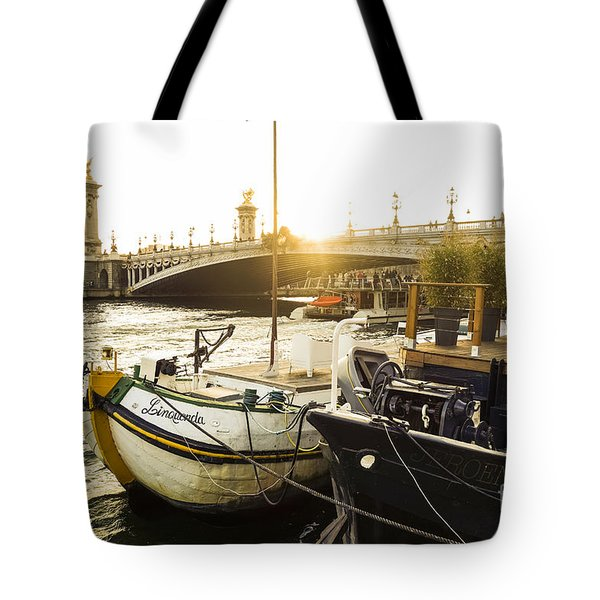Seine River With Barges And Boats, Pont De Alexandre Bridge Behind, Paris France. Tote Bag by Perry Van Munster