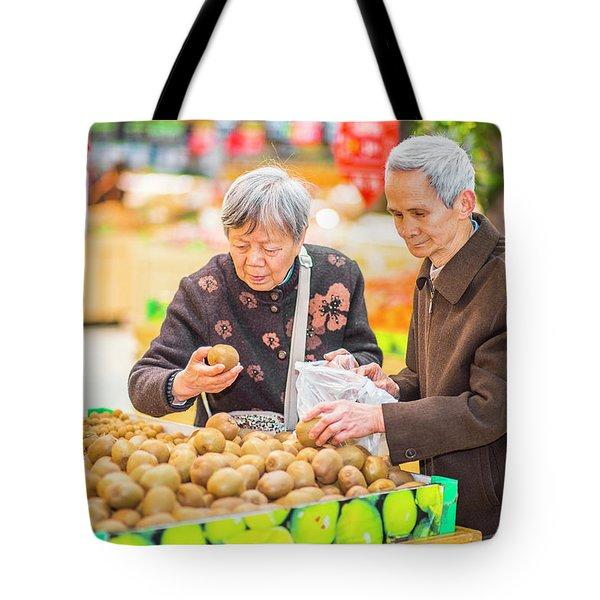 Senior Man And Woman Shopping Fruit Tote Bag