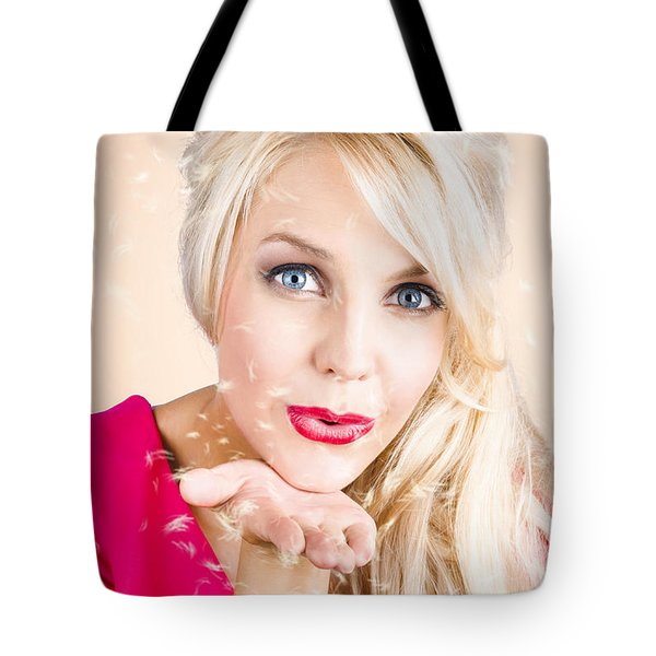 Tote Bag featuring the photograph Sensual Woman Blowing Special Dandelion Kiss by Jorgo Photography - Wall Art Gallery