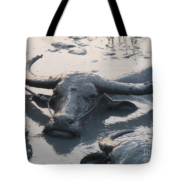 Several Water Buffalos Wallowing In A Mud Hole In Asia - Closer Tote Bag by Jason Rosette
