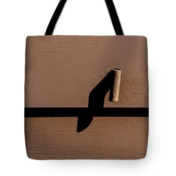 Tote Bag featuring the photograph Shadow Handle by Britt Runyon