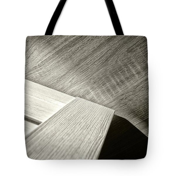 Tote Bag featuring the photograph Shadow Light Door Abstract Two by John Williams
