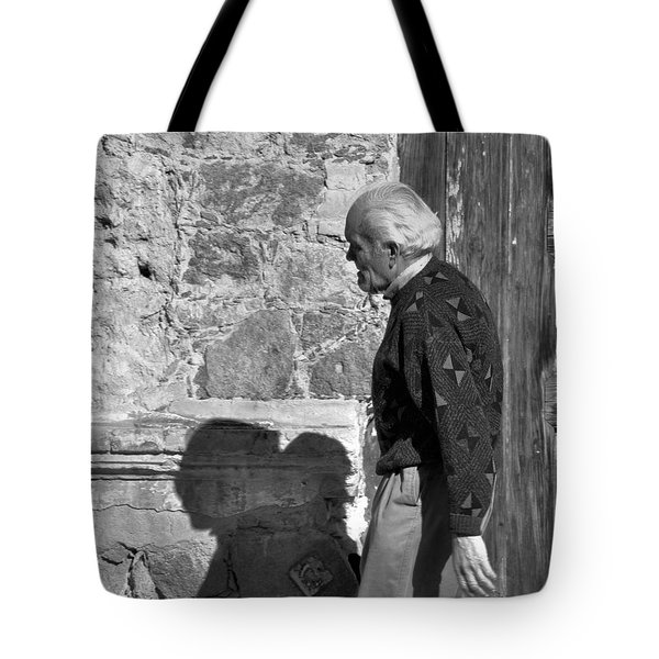 Tote Bag featuring the photograph Shadow Of A Man by Jim Walls PhotoArtist