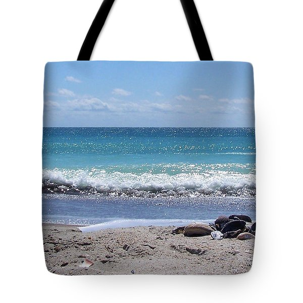 Tote Bag featuring the photograph Shells On The Beach by Sandi OReilly