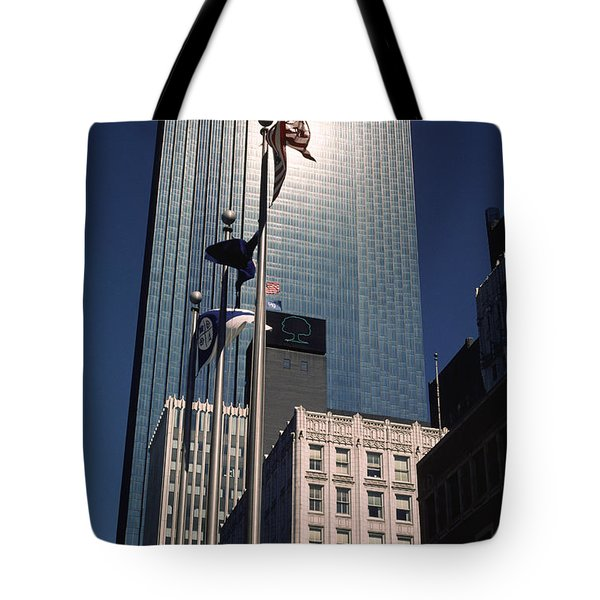 Tote Bag featuring the photograph Shimmering Ids by Mike Evangelist