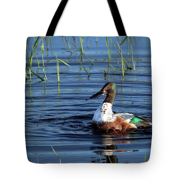 Tote Bag featuring the photograph Shoveler by Jean Noren