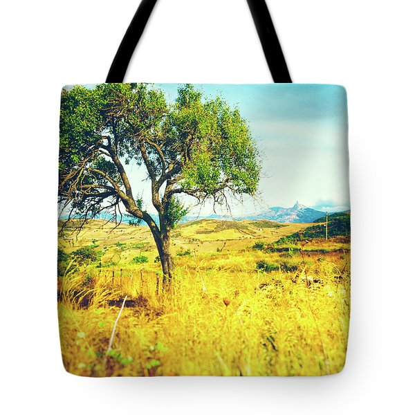 Tote Bag featuring the photograph Sicilian Landscape With Tree by Silvia Ganora