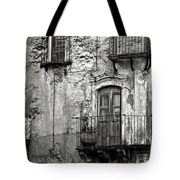 Tote Bag featuring the photograph Sicilian Medieval Facade by Silva Wischeropp