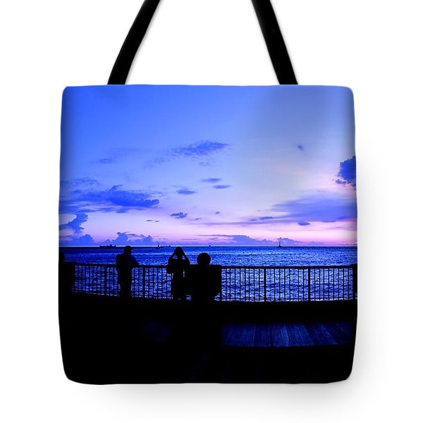 Tote Bag featuring the photograph Silhouette Of People At Sunset by Yali Shi