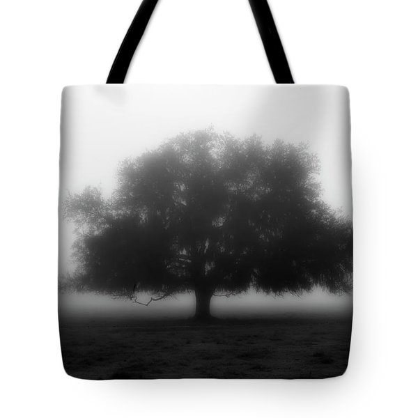 Silhouette Of Tree In Field Tote Bag