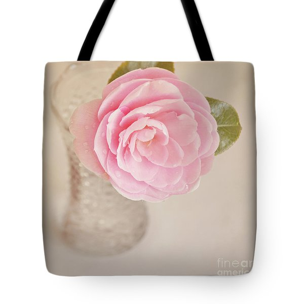 Tote Bag featuring the photograph Single Pink Camelia Flower In Clear Vase by Lyn Randle