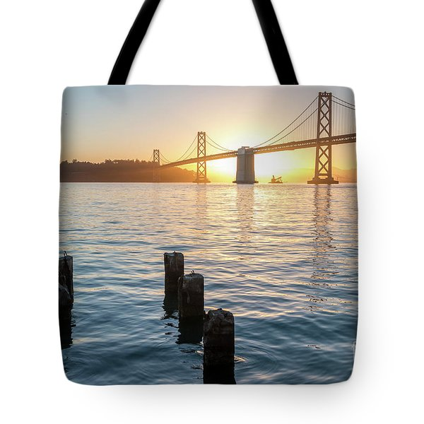 Six Pillars Sticking Out The Water With Bay Bridge In The Backgr Tote Bag