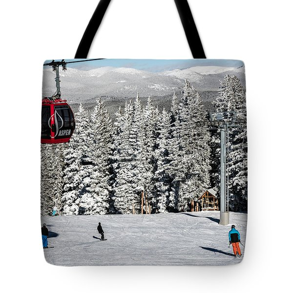 Skiers Limber Up Under A Gondola Near The Summit Of Aspen Mountain Tote Bag