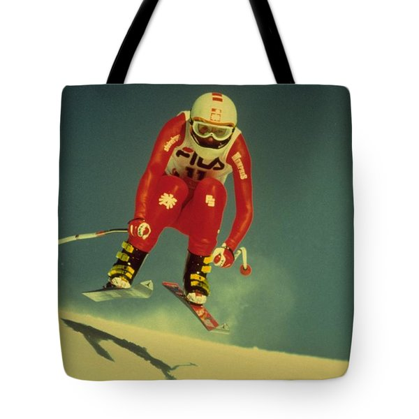 Tote Bag featuring the photograph Skiing In Crans Montana by Travel Pics