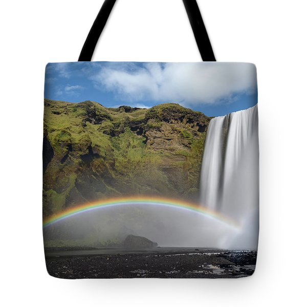 Tote Bag featuring the photograph Skogafoss And Companion Rainbow by Rikk Flohr