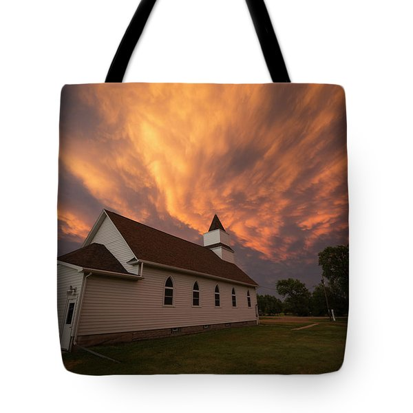 Tote Bag featuring the photograph Sky Of Fire by Aaron J Groen
