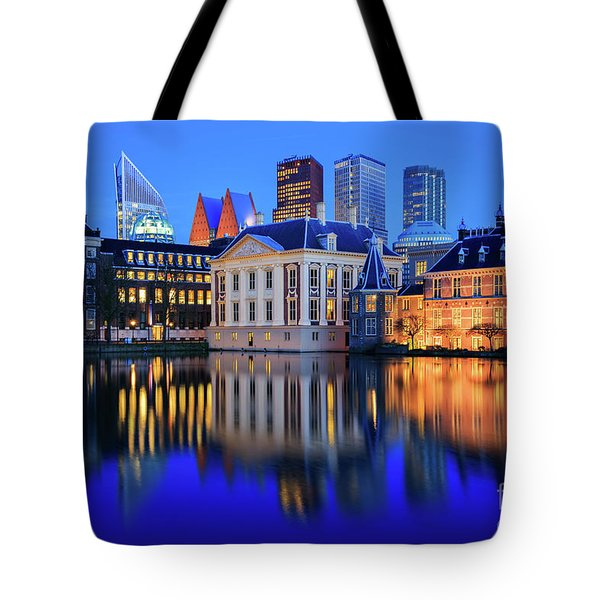Tote Bag featuring the photograph Skyline Of The Hague At Dusk During Blue Hour by IPics Photography