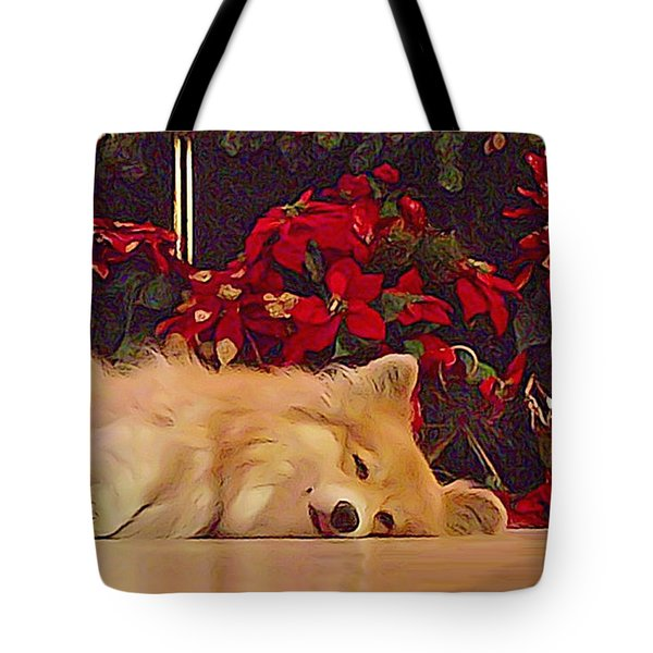 Tote Bag featuring the photograph Sleepy Holiday Corgi Surrounded By Poinsettias. by Kathy Kelly