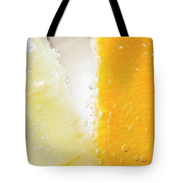 Slice Of Orange And Lemon In Cocktail Glass Tote Bag