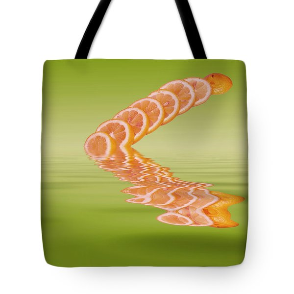 Tote Bag featuring the photograph Slices Pink Grapefruit Citrus Fruit by David French