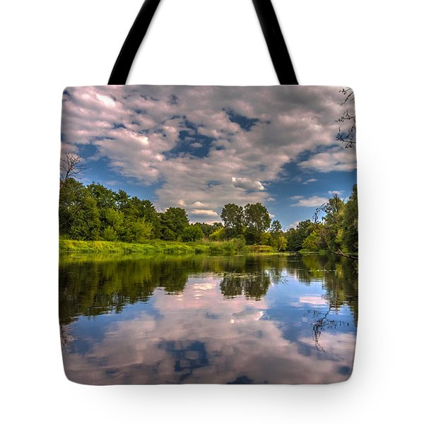 Tote Bag featuring the photograph Slow River Reflections by Julis Simo