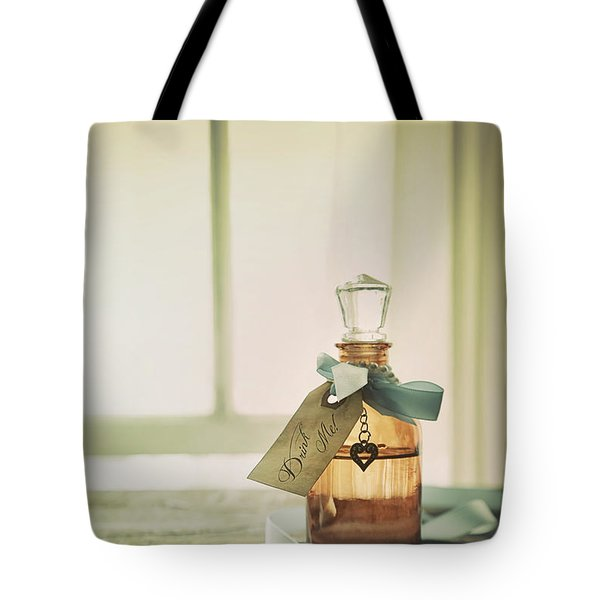 Small Bottle With Ribbon And Tag Tote Bag by Sandra Cunningham