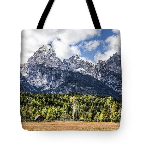 Small Cabin Below Big Mountain Tote Bag